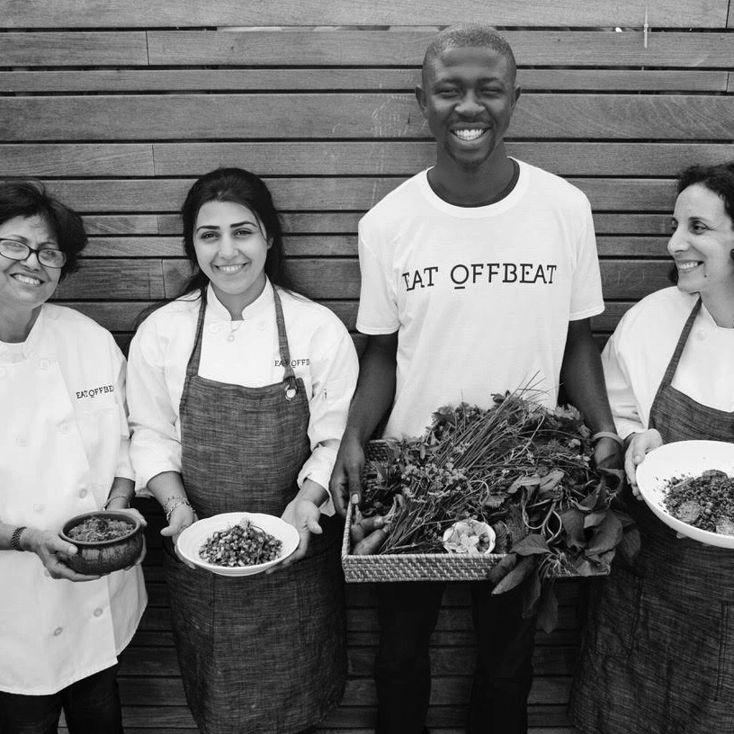 Eat Offbeat staff members holding different dishes as well as freshly picked items.